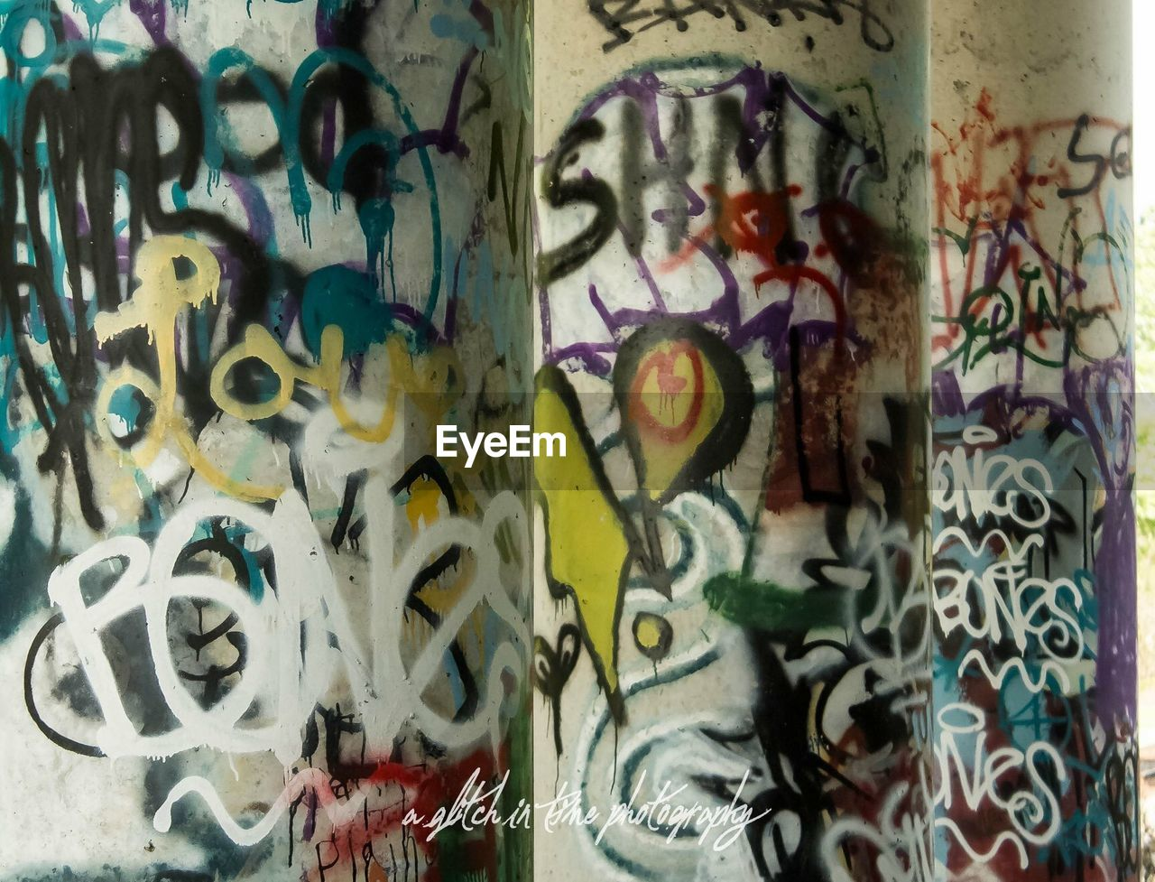 graffiti, multi colored, creativity, art and craft, no people, wall - building feature, backgrounds, full frame, pattern, built structure, text, architecture, indoors, street art, close-up, design, wall, day, messy, floral pattern, mural