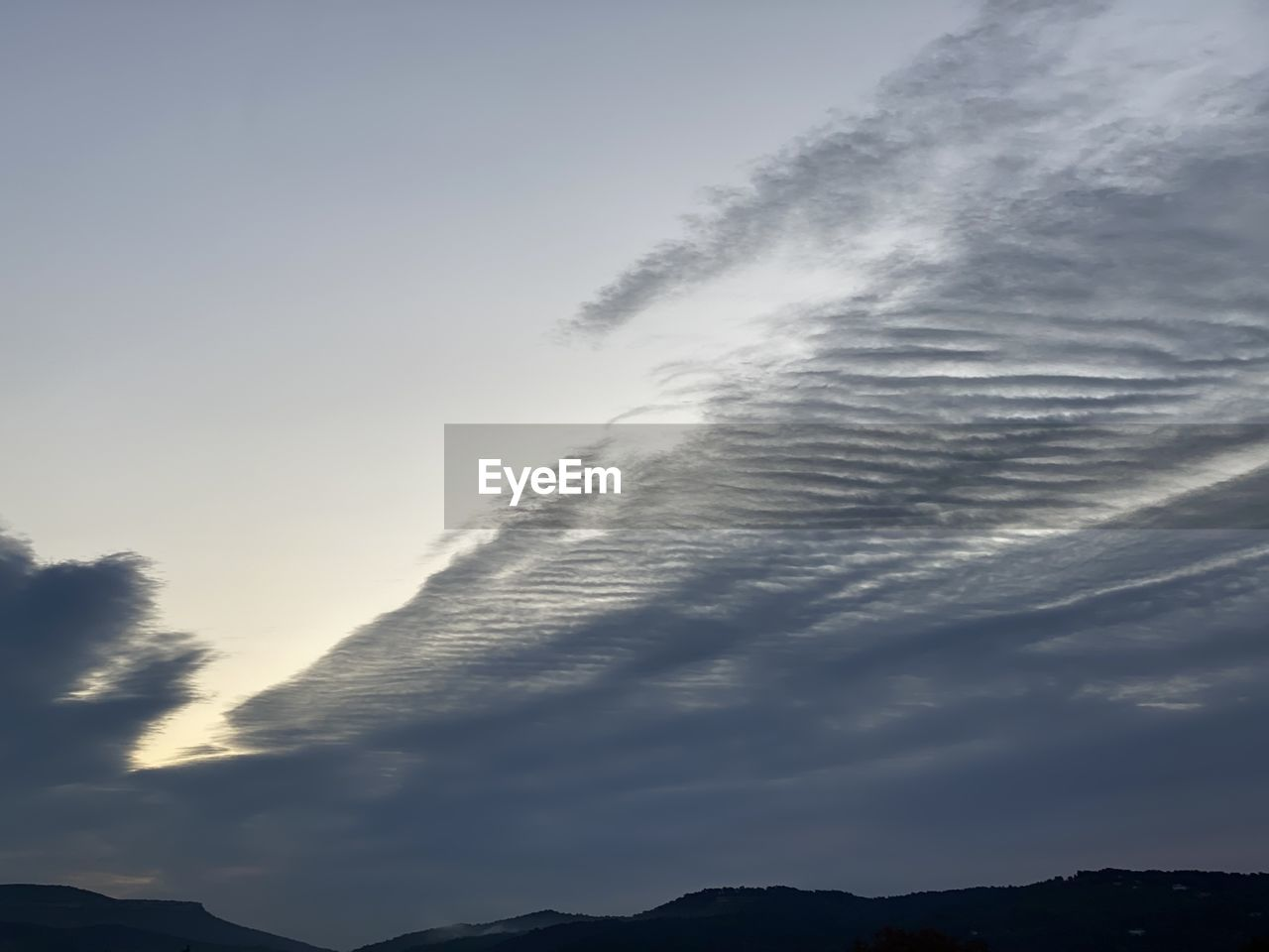 sky, cloud - sky, beauty in nature, low angle view, tranquility, silhouette, no people, scenics - nature, tranquil scene, nature, mountain, outdoors, day, sunset, idyllic, environment, non-urban scene, mountain range, fog
