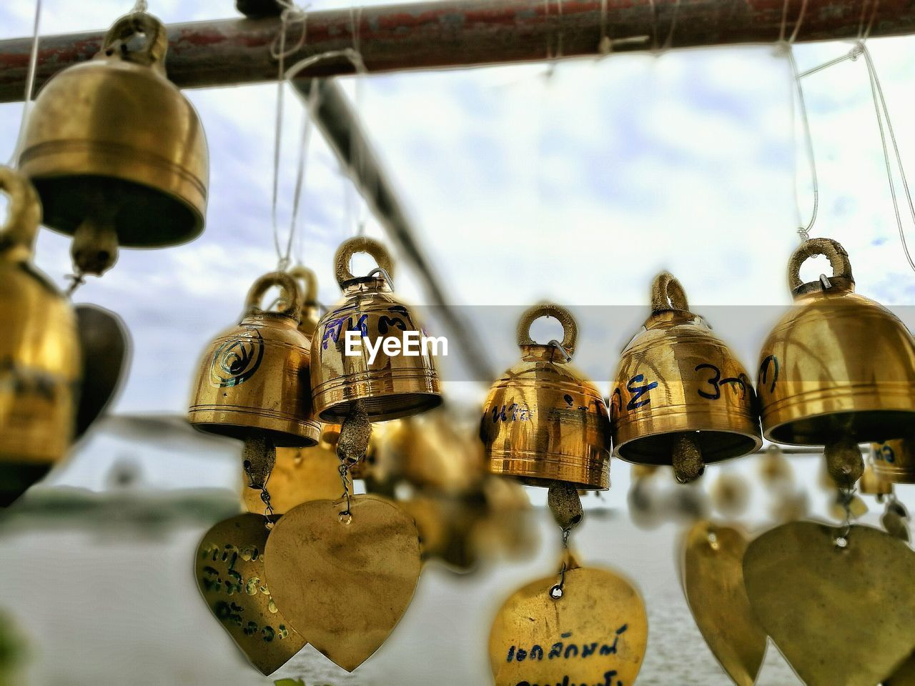 hanging, metal, bell, for sale, no people, close-up, day, gold colored, retail, indoors, nautical vessel, sky