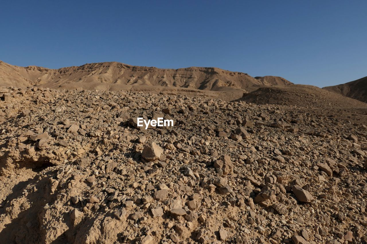 sky, clear sky, landscape, scenics - nature, nature, mountain, rock, land, environment, desert, tranquil scene, no people, copy space, tranquility, beauty in nature, arid climate, day, rock - object, non-urban scene, climate, outdoors, formation, eroded