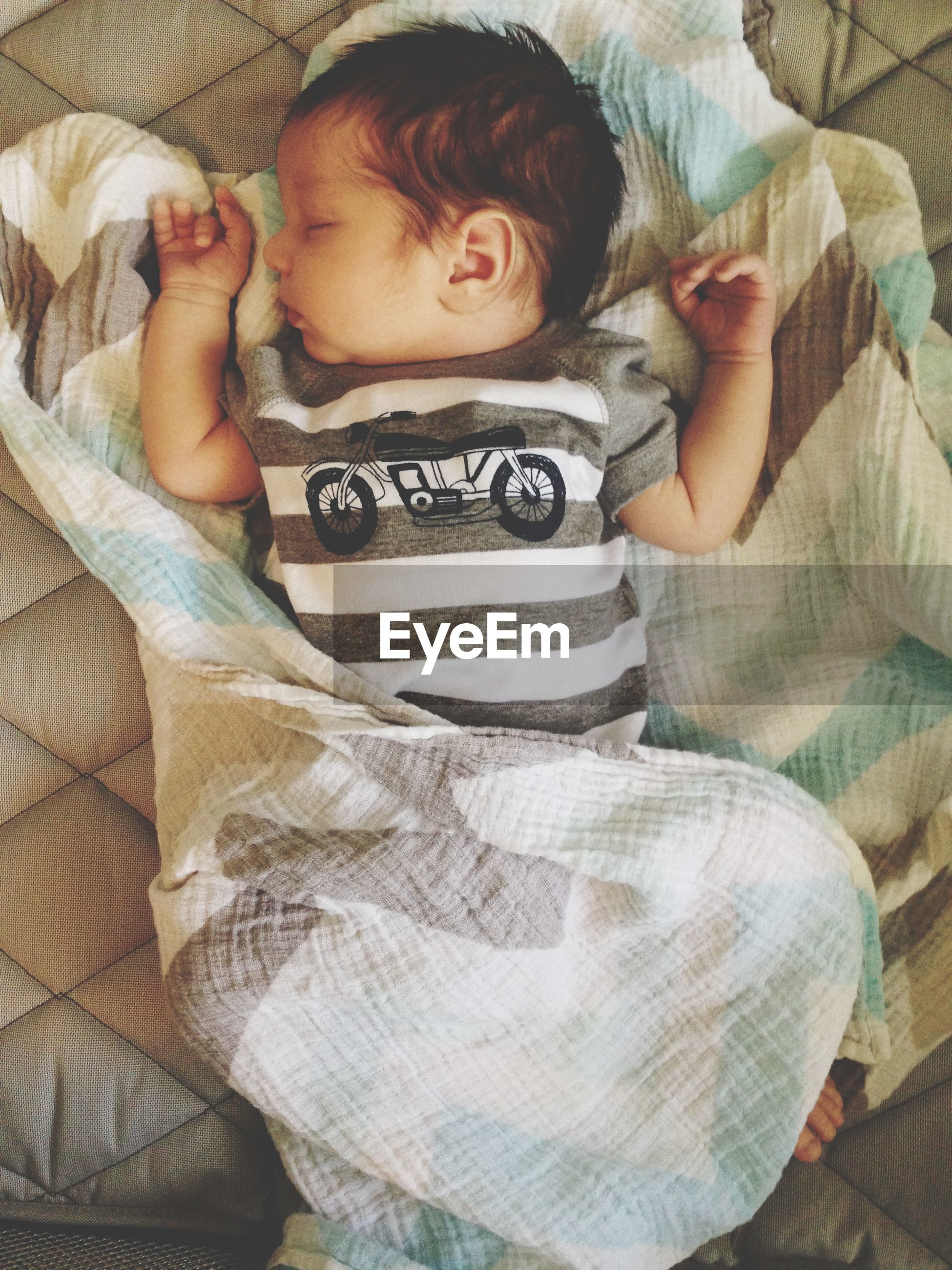 indoors, person, bed, childhood, lifestyles, relaxation, casual clothing, high angle view, leisure activity, home interior, innocence, bonding, lying down, baby, toddler, togetherness, sleeping, babyhood