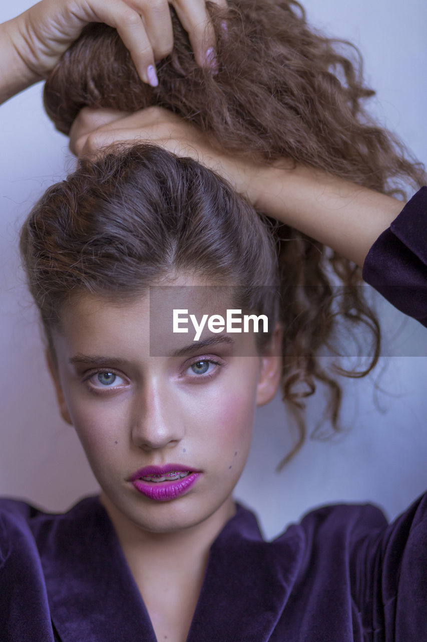 portrait, headshot, looking at camera, front view, real people, lifestyles, indoors, leisure activity, brown hair, young adult, people, casual clothing, two people, human body part, adult, hair, close-up, women, hairstyle, teenager, human hair, teenage boys