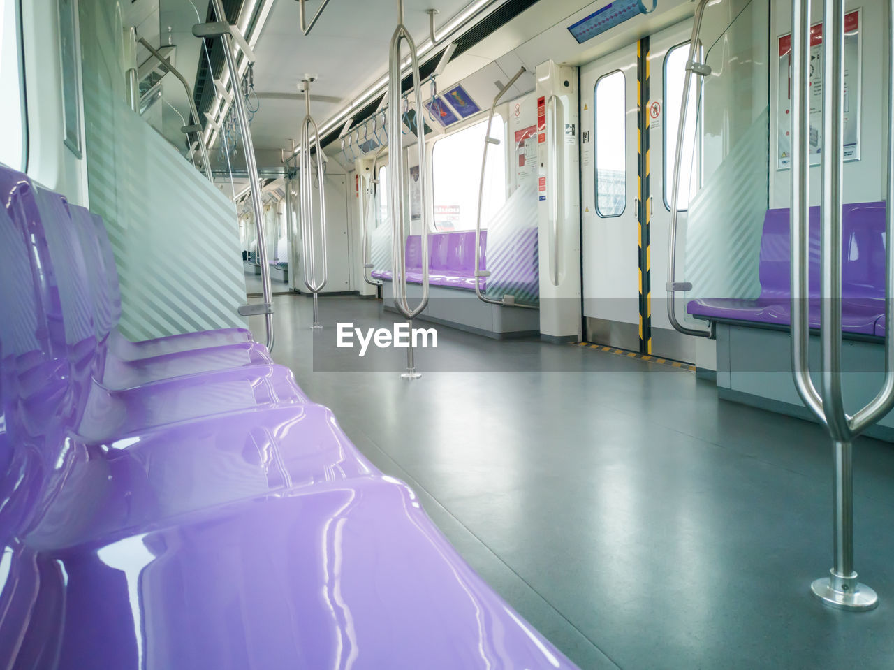 purple, indoors, illuminated, empty, rail transportation, vehicle interior, transportation, public transportation, mode of transportation, no people, healthcare and medicine, train, architecture, seat, absence, hospital, train - vehicle, lighting equipment, vehicle seat, travel