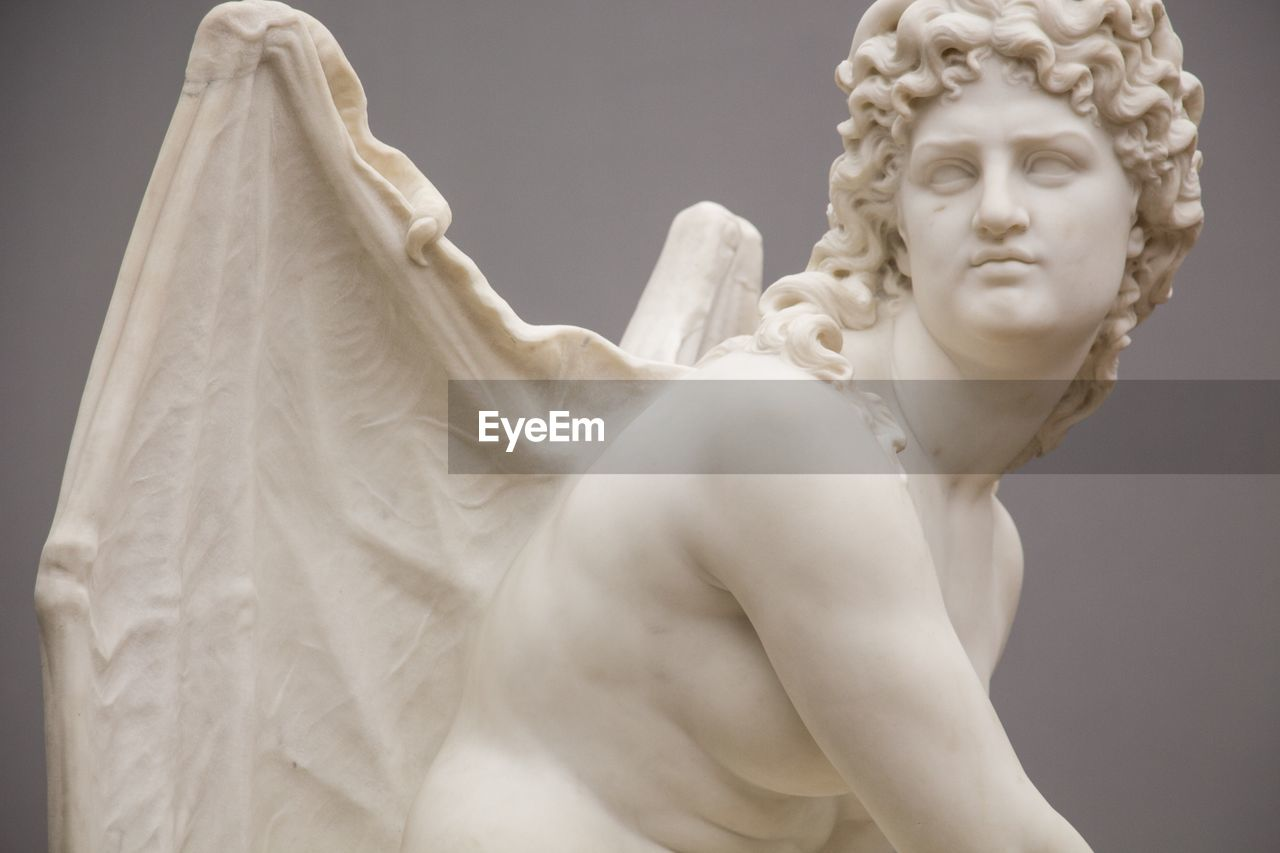 sculpture, art and craft, statue, human representation, female likeness, representation, creativity, male likeness, low angle view, no people, angel, craft, shirtless, close-up, architecture, beauty, day, white color, religion, fine art statue