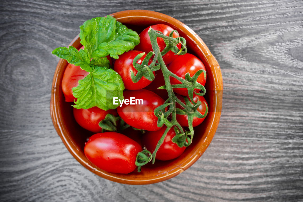 food and drink, food, healthy eating, vegetable, wellbeing, red, freshness, directly above, tomato, table, fruit, bowl, indoors, close-up, no people, high angle view, still life, green color, herb, wood - material, vegetarian food
