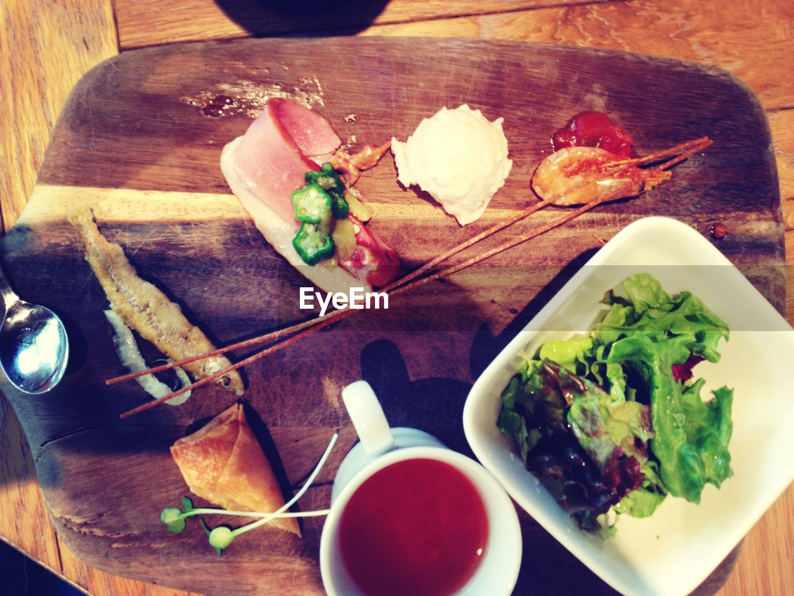 food and drink, indoors, freshness, food, table, plate, still life, high angle view, ready-to-eat, healthy eating, meal, serving size, bowl, vegetable, directly above, leaf, wood - material, salad, meat, served