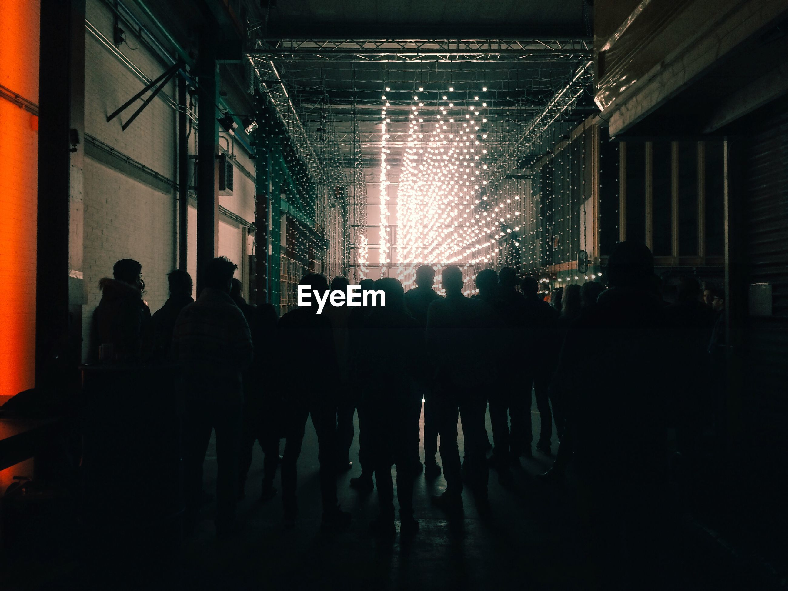Silhouette of people walking at night