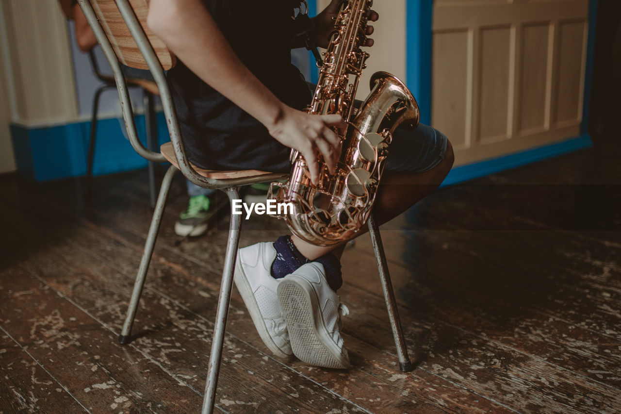 Low Section Of Man Playing Saxophone