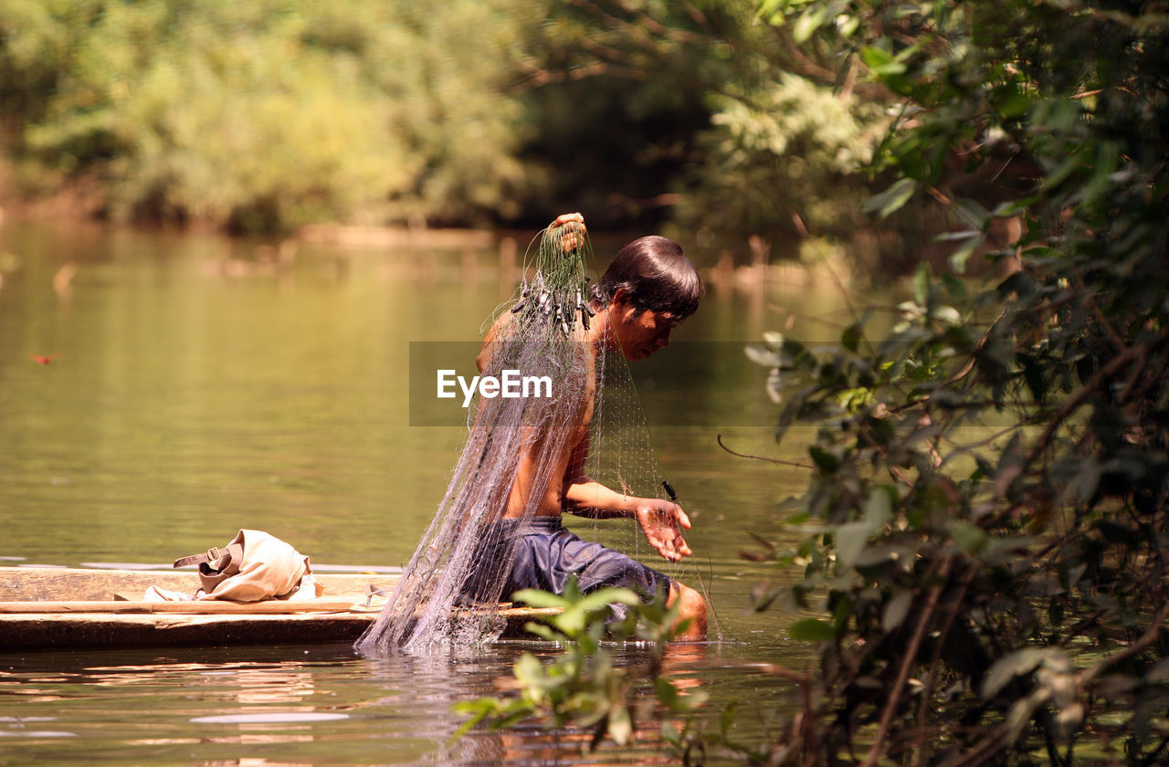 Fisherman With Net At River