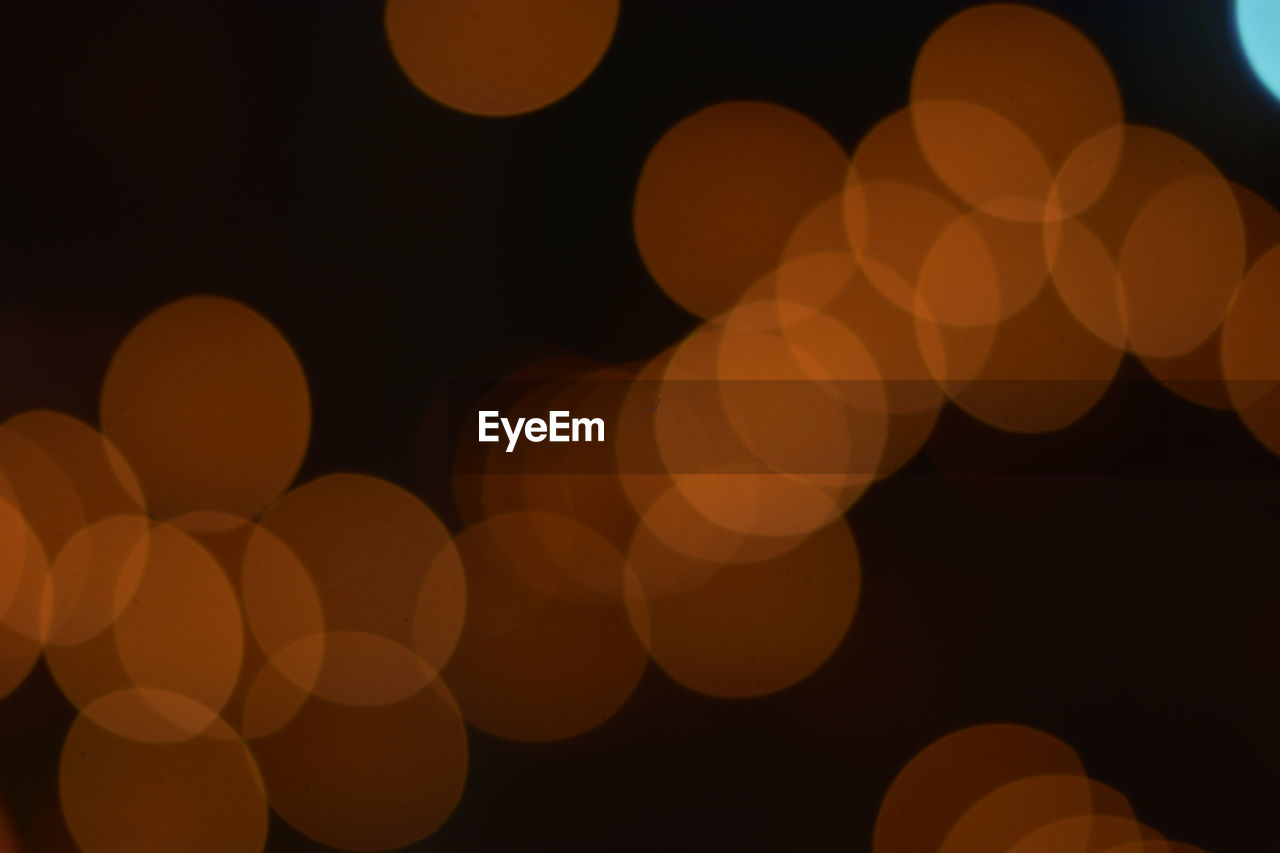 illuminated, night, glowing, defocused, lighting equipment, circle, light - natural phenomenon, geometric shape, shape, pattern, abstract, no people, light, design, lens flare, electric light, full frame, backgrounds, orange color, close-up, electricity, black background, abstract backgrounds