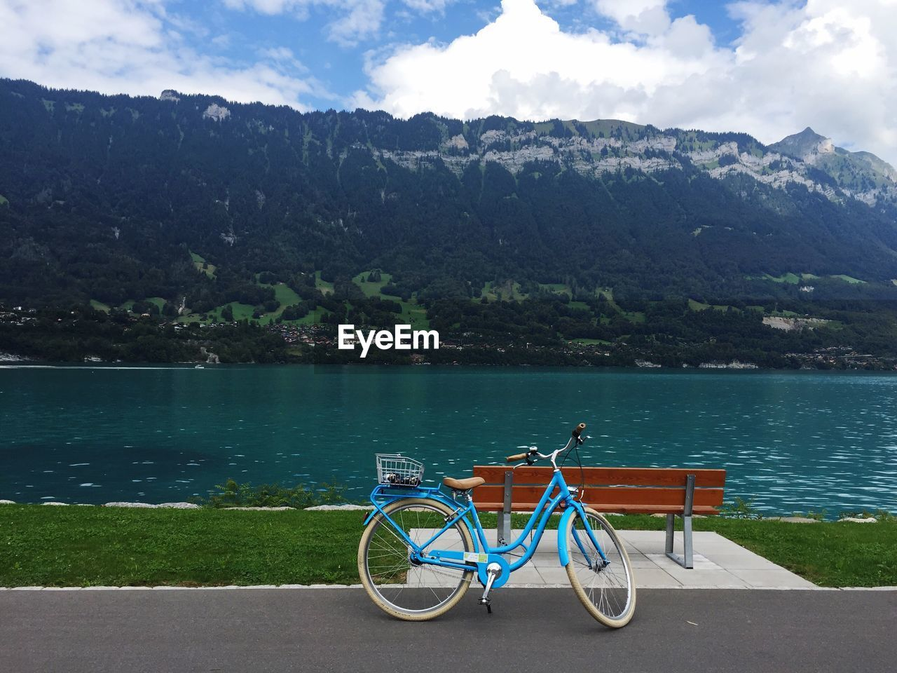 Bicycle parked by lake