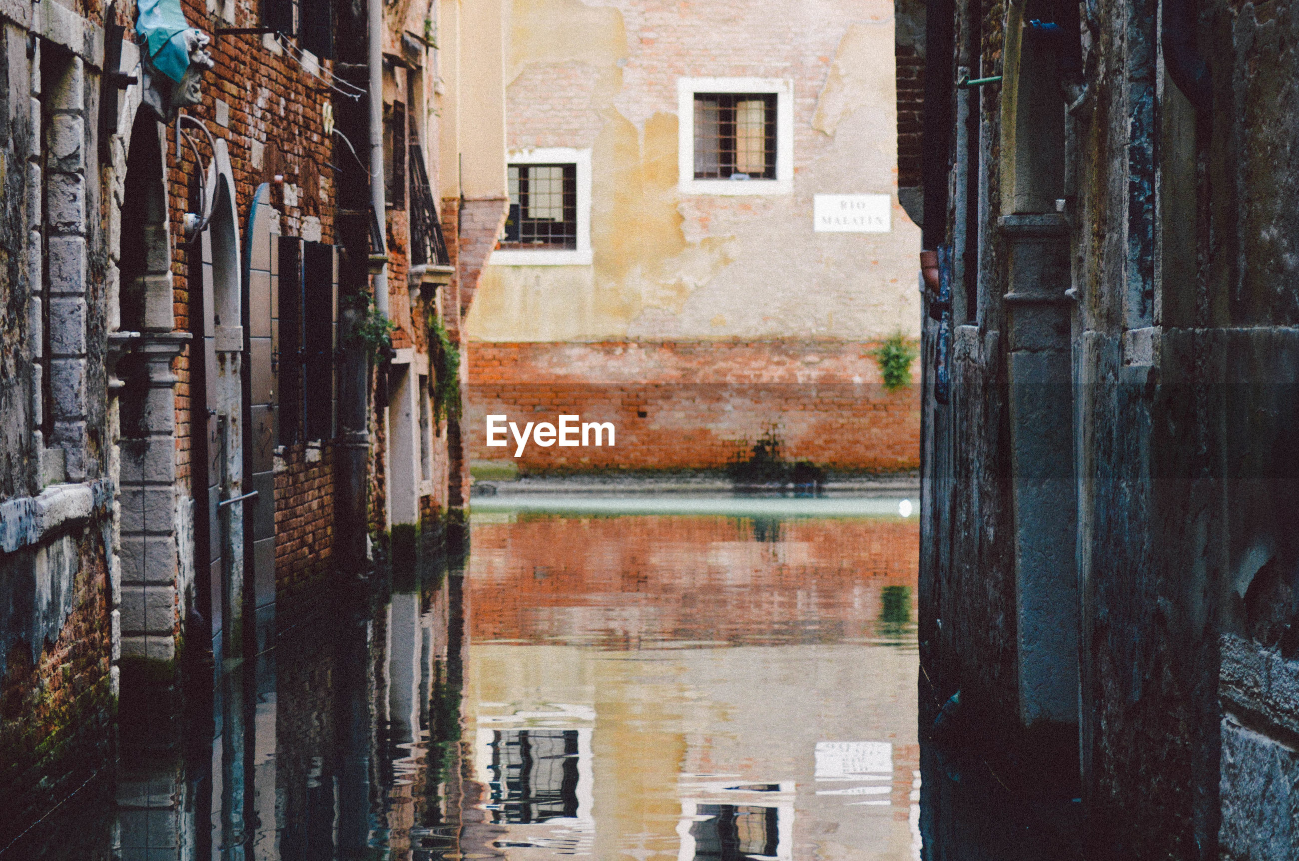 View of narrow canal in venice