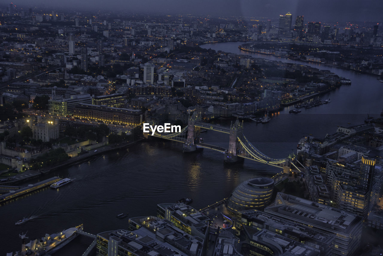 High Angle View Of Illuminated Tower Bridge Over Thames River At Dusk
