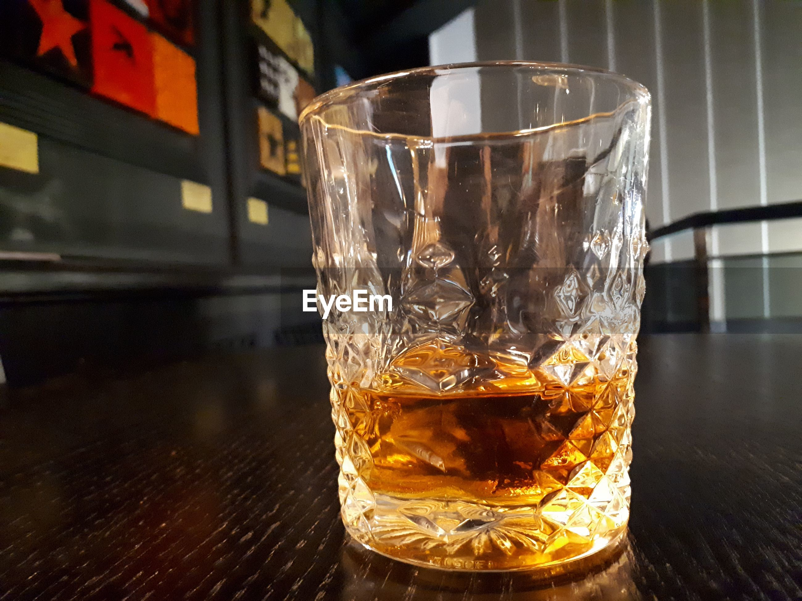 Close-up of whiskey glass on table