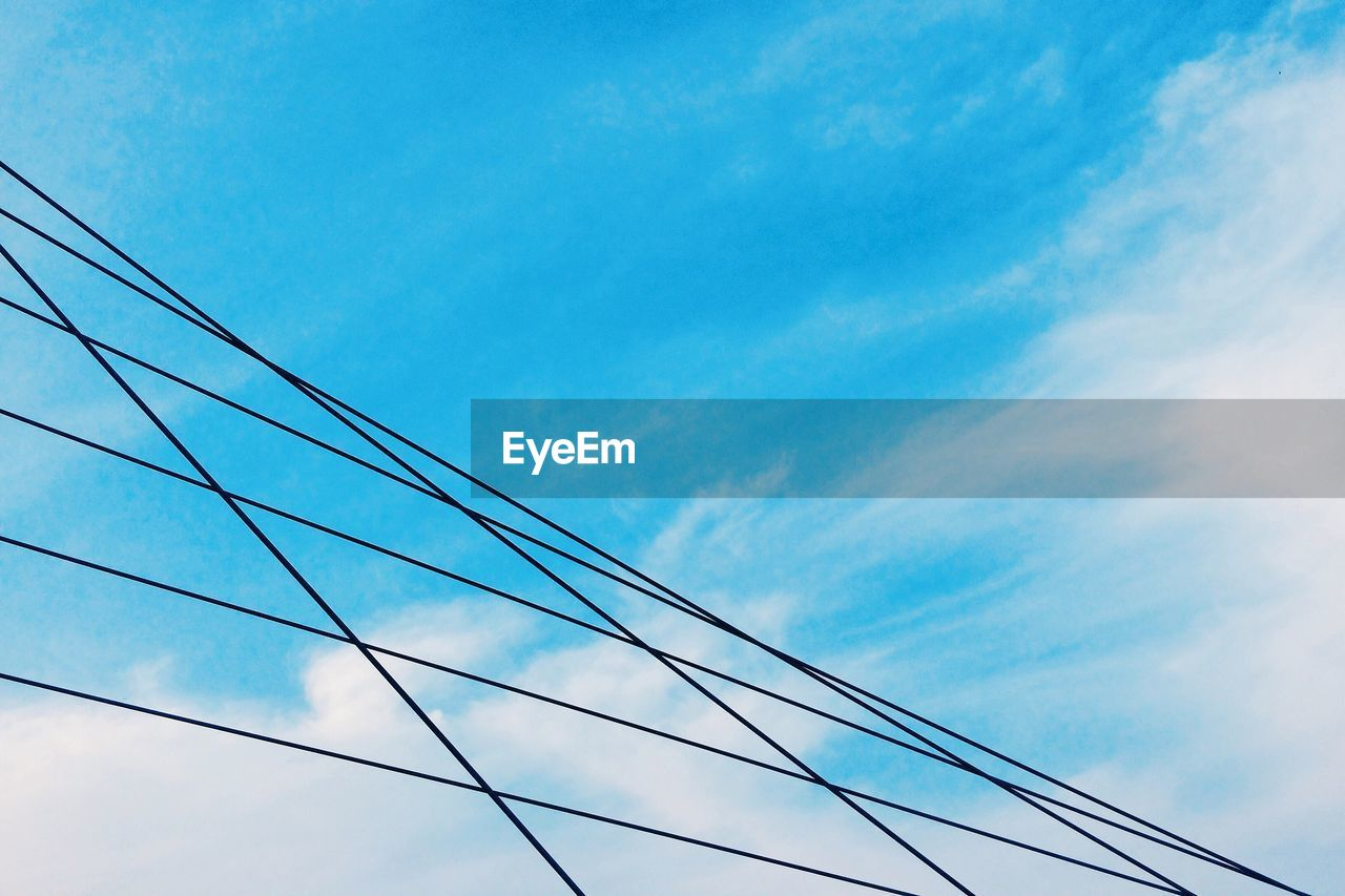 Low Angle View Of Steel Cables Against Sky