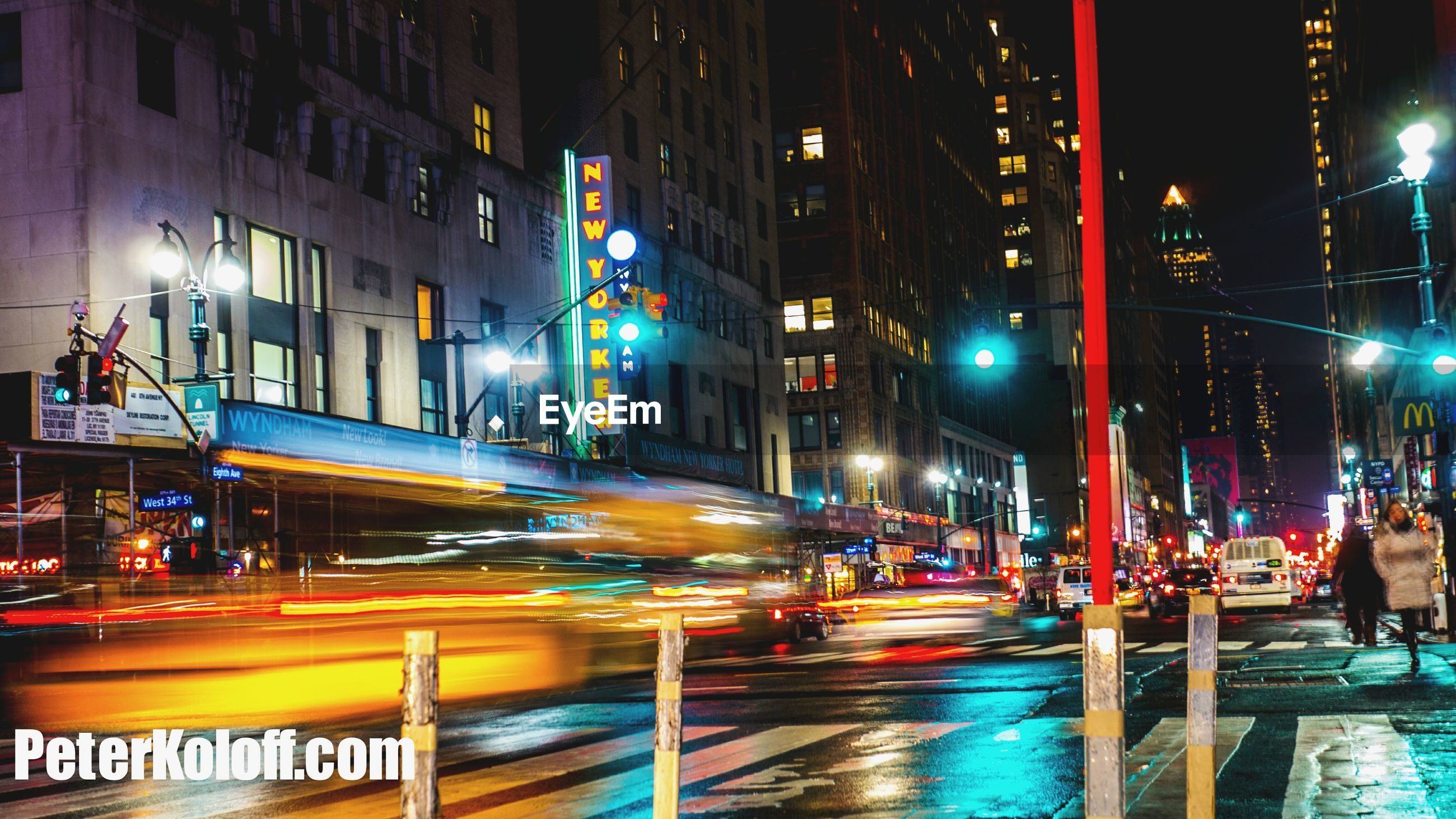 illuminated, night, city, building exterior, architecture, built structure, transportation, long exposure, motion, light trail, street, city life, speed, blurred motion, city street, street light, road, lighting equipment, on the move, car