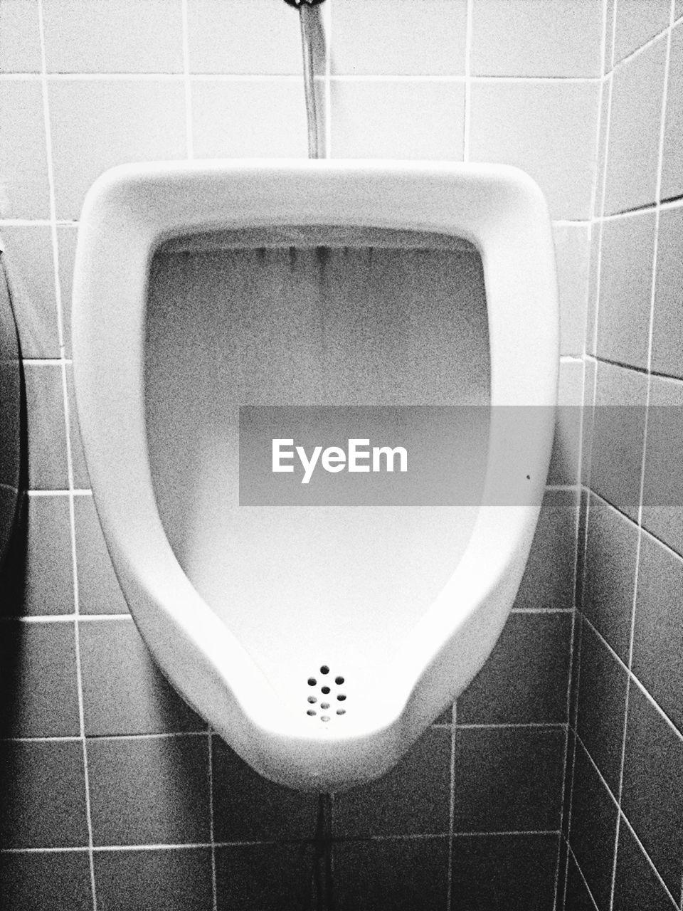 Close-up of urinal