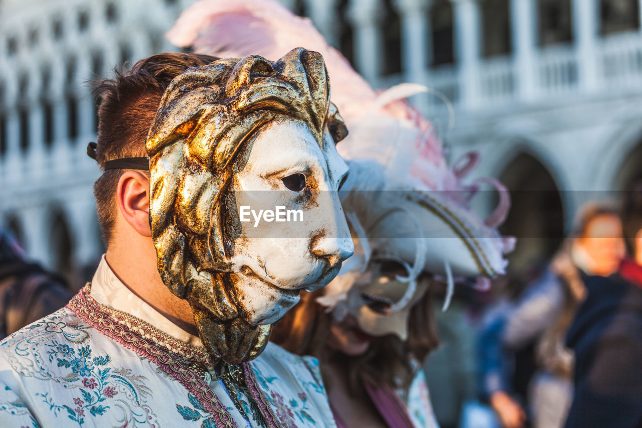 focus on foreground, sculpture, creativity, art and craft, representation, close-up, real people, day, incidental people, headshot, lifestyles, arts culture and entertainment, leisure activity, mammal, statue, people, architecture, carnival - celebration event