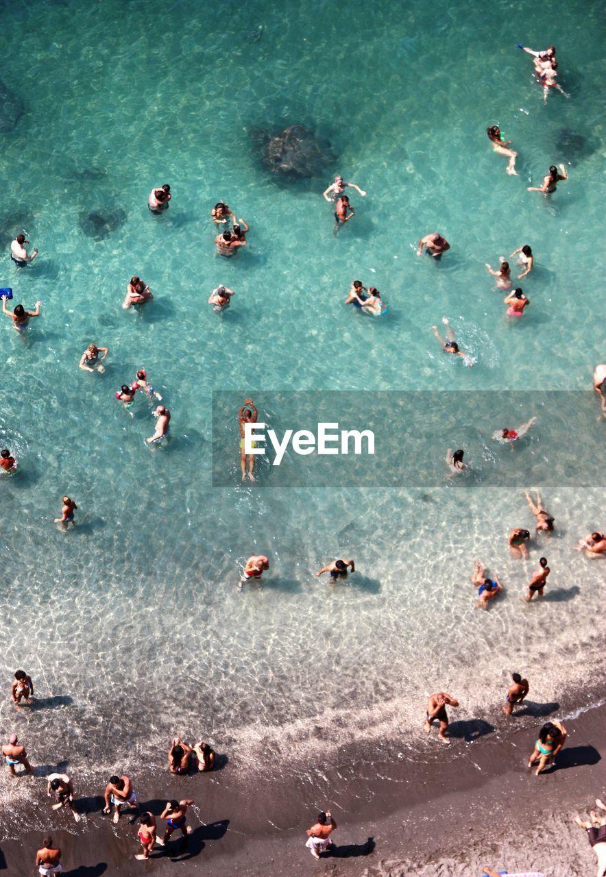 High Angle View Of People Enjoying Summer At Sea