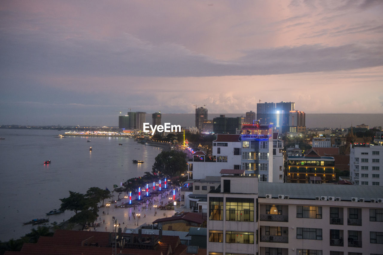 building exterior, architecture, built structure, city, sky, building, cloud - sky, illuminated, water, nature, no people, high angle view, cityscape, residential district, outdoors, night, sea, sunset, reflection