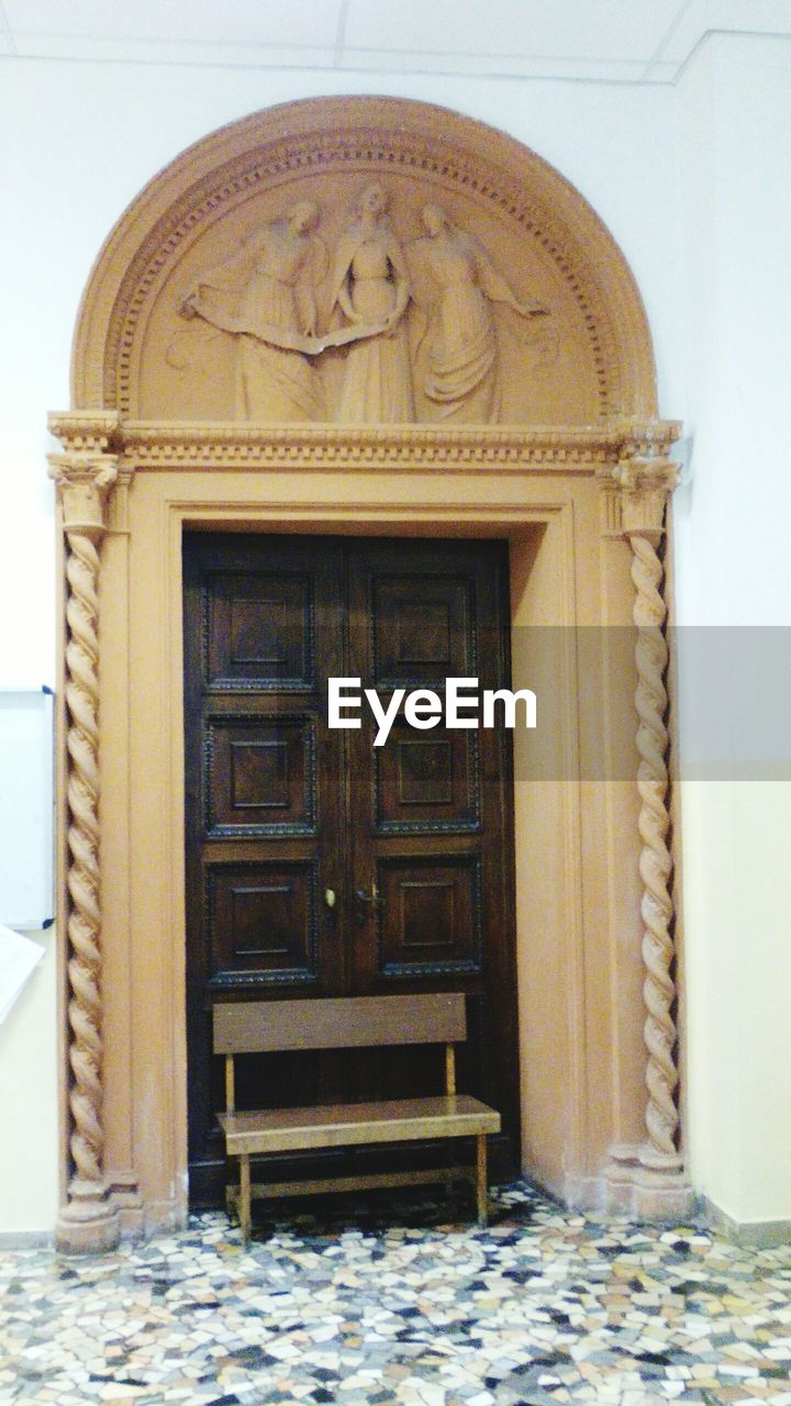 architecture, built structure, door, no people, entrance, building, building exterior, day, closed, the past, history, outdoors, wall - building feature, art and craft, representation, craft, house, arch, ornate, bas relief