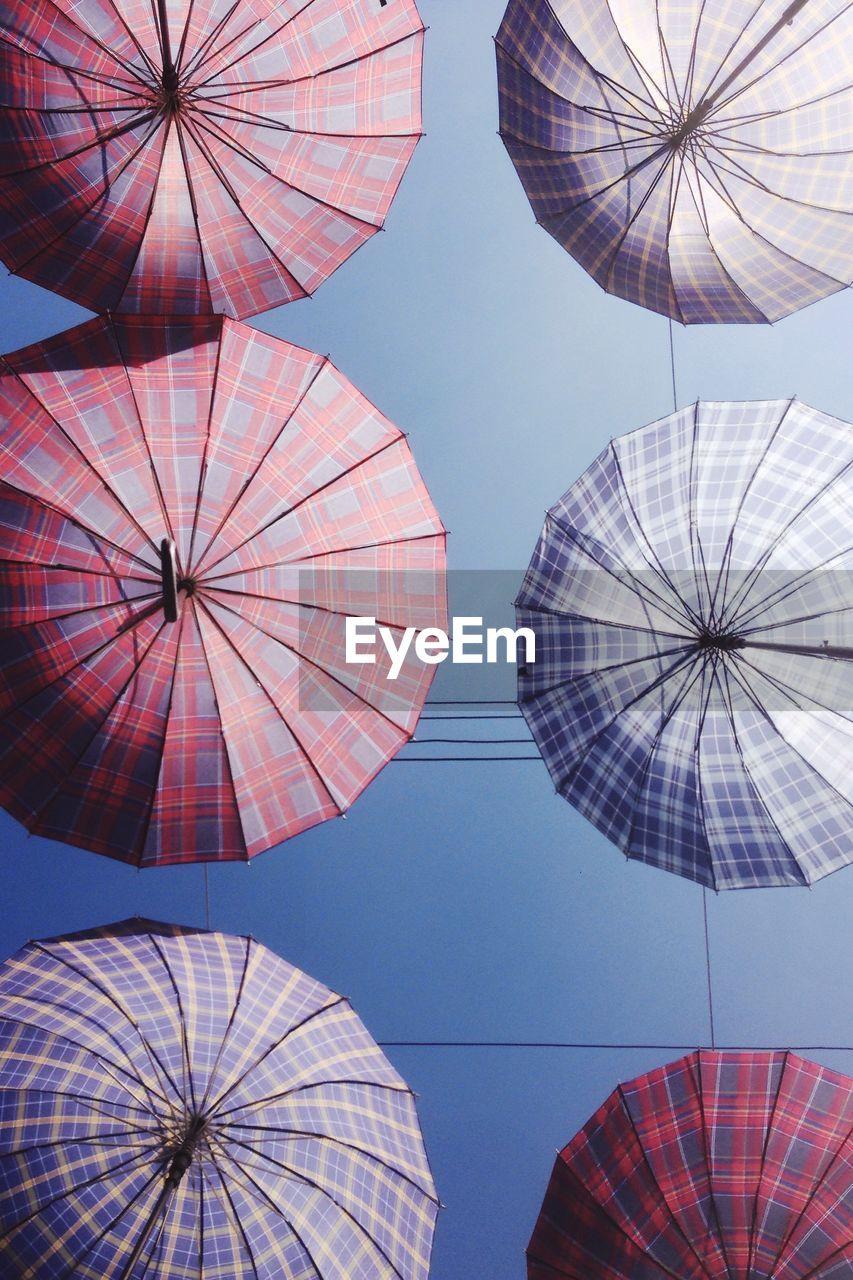 Directly Below View Of Umbrellas Hanging Against Sky