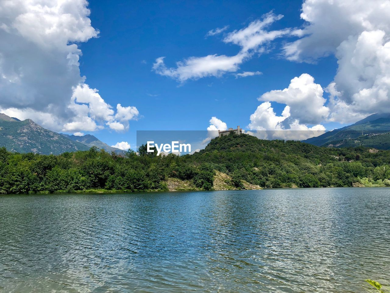 cloud - sky, water, scenics - nature, sky, beauty in nature, mountain, tranquil scene, tranquility, lake, tree, waterfront, non-urban scene, day, no people, plant, nature, idyllic, remote, mountain range, outdoors, range