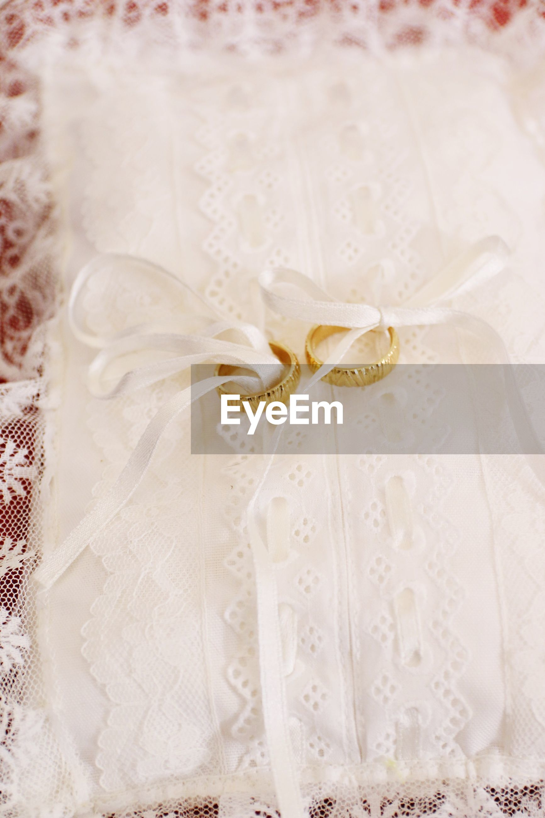 Close-up of wedding rings on white fabric