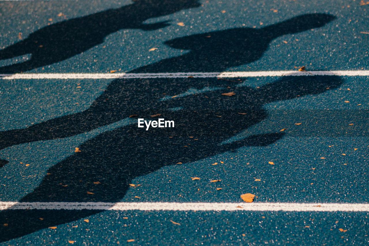 Close-Up Of Shadows On Ground