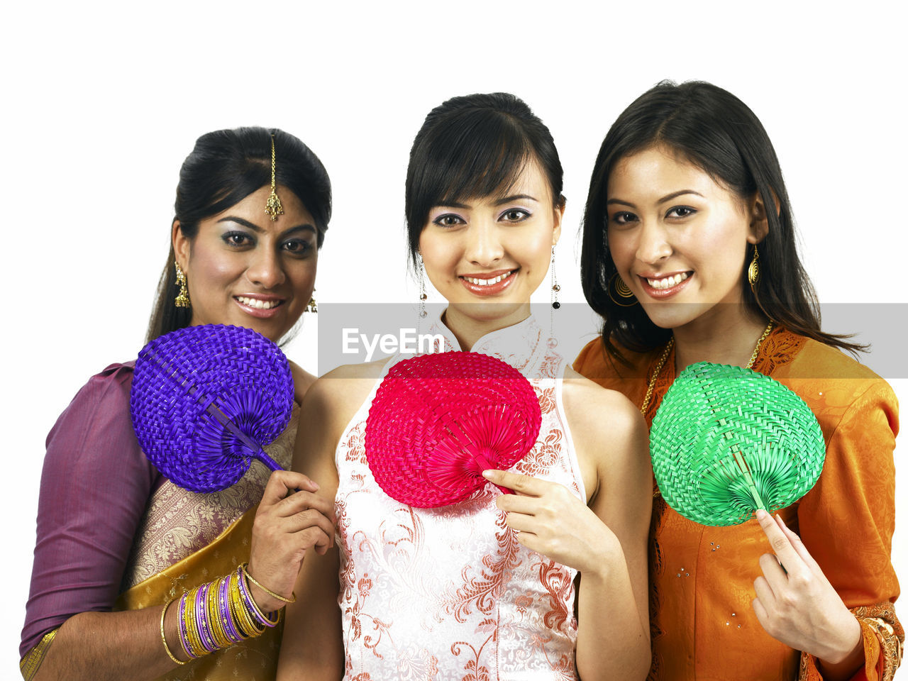 Portrait Of Happy Young Friends Standing Against White Background