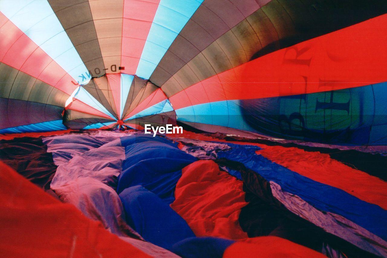 Multi Colored Parachute On Field