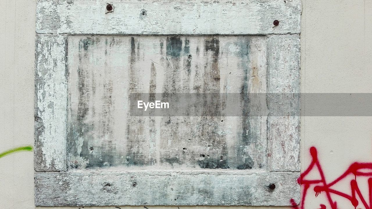 wall - building feature, architecture, built structure, no people, text, day, safety, western script, weathered, building exterior, communication, old, red, wood - material, security, metal, sign, protection, outdoors, closed
