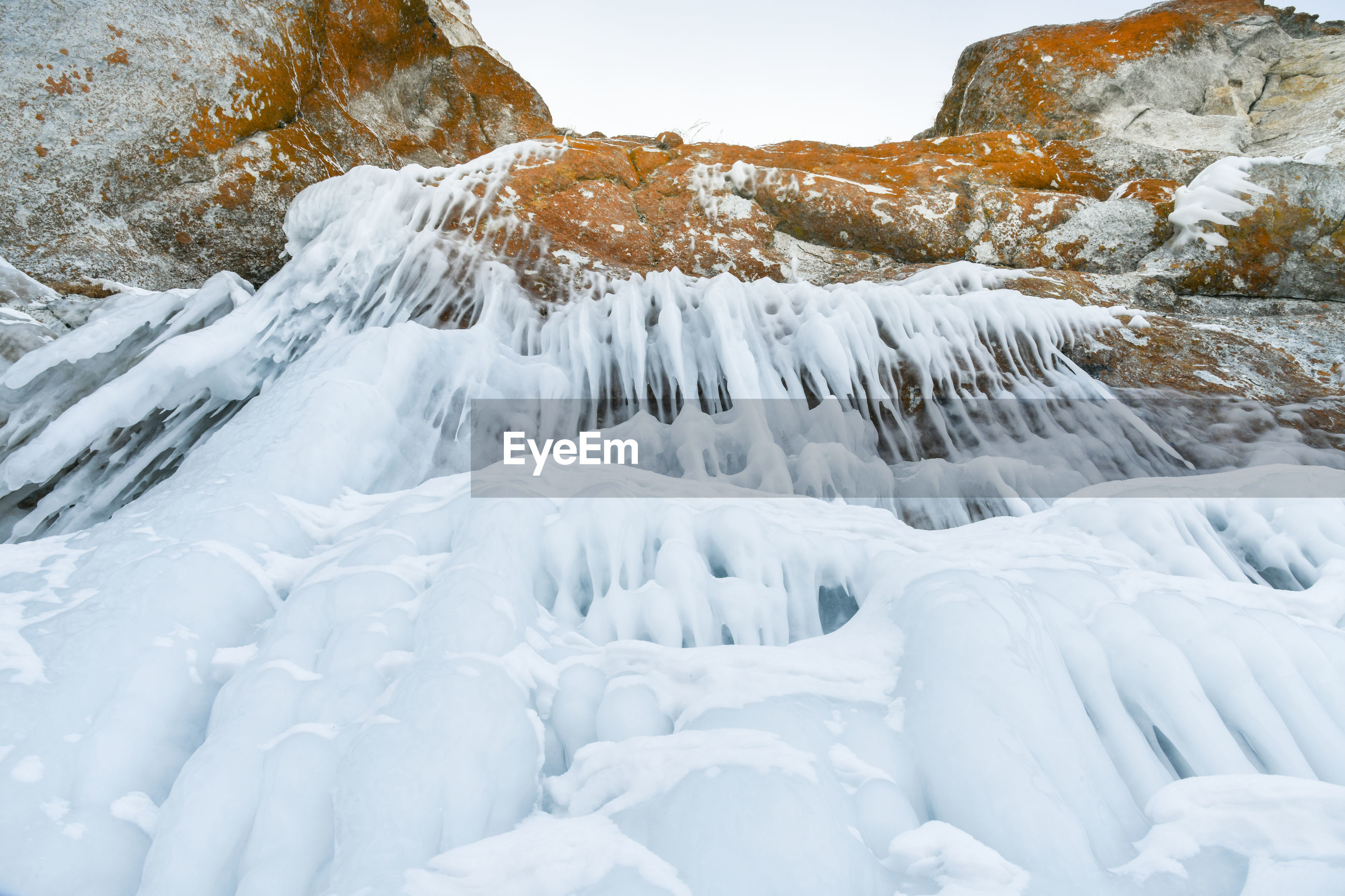 SNOW COVERED LANDSCAPE AGAINST WHITE BACKGROUND