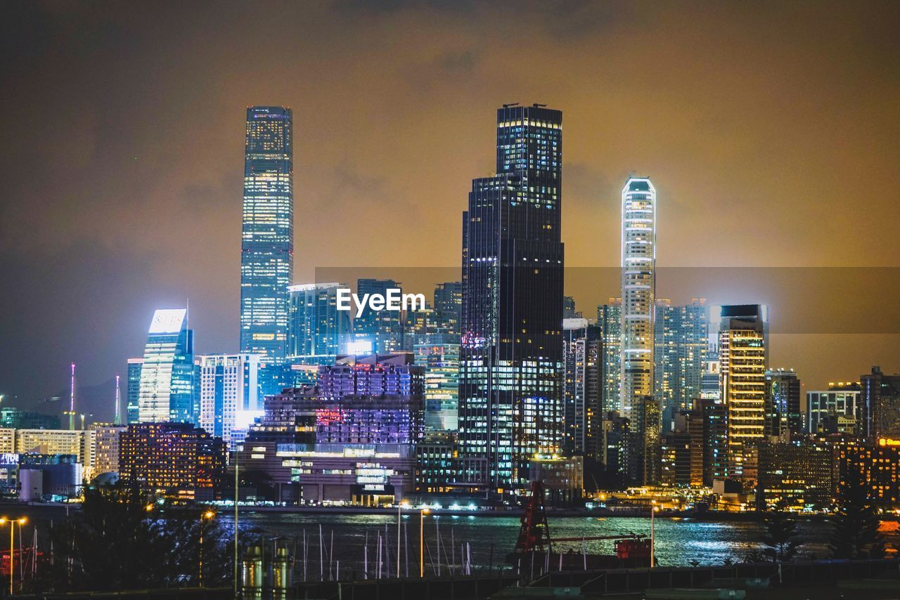 building exterior, built structure, architecture, city, building, illuminated, tall - high, sky, cityscape, modern, urban skyline, office building exterior, night, skyscraper, landscape, office, residential district, tower, no people, nature, financial district, outdoors, light
