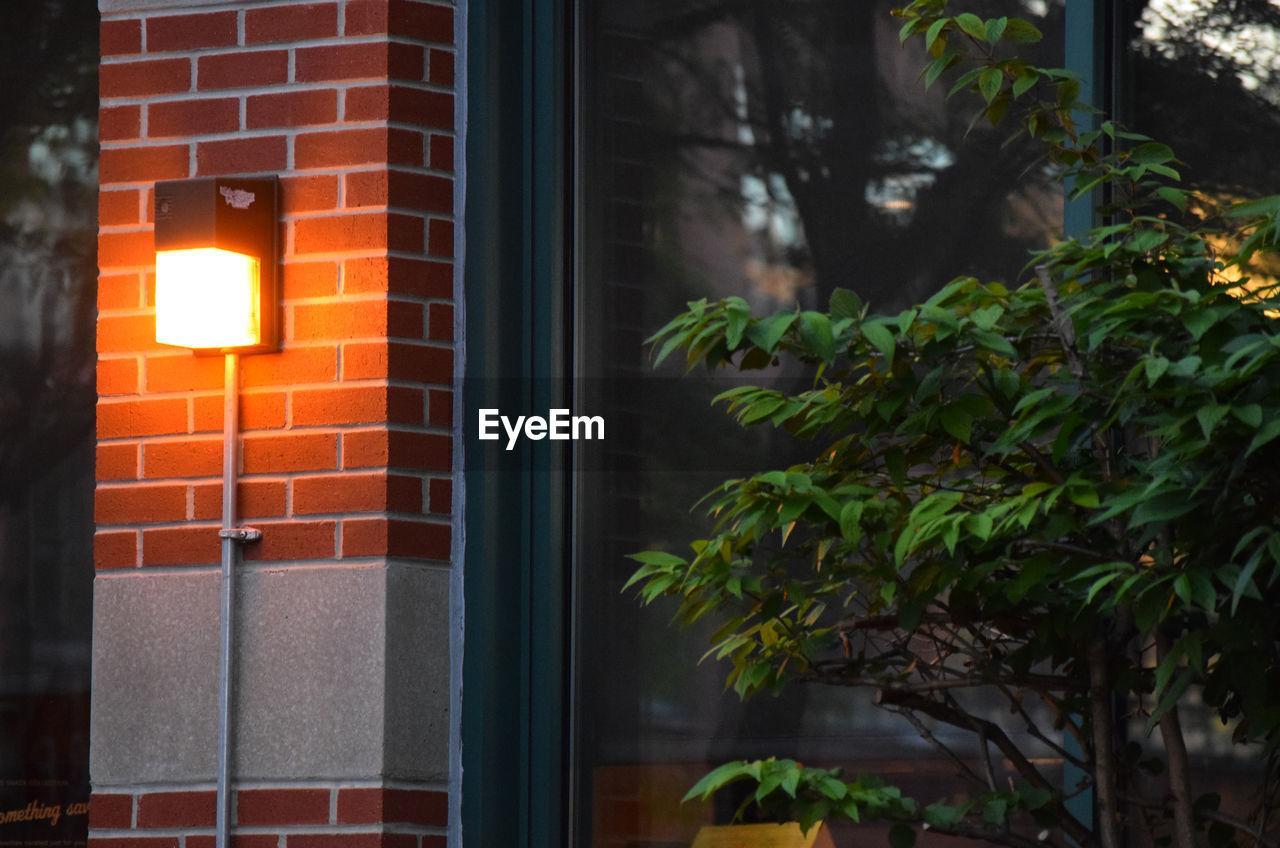 Illuminated Lantern Attached To Wall