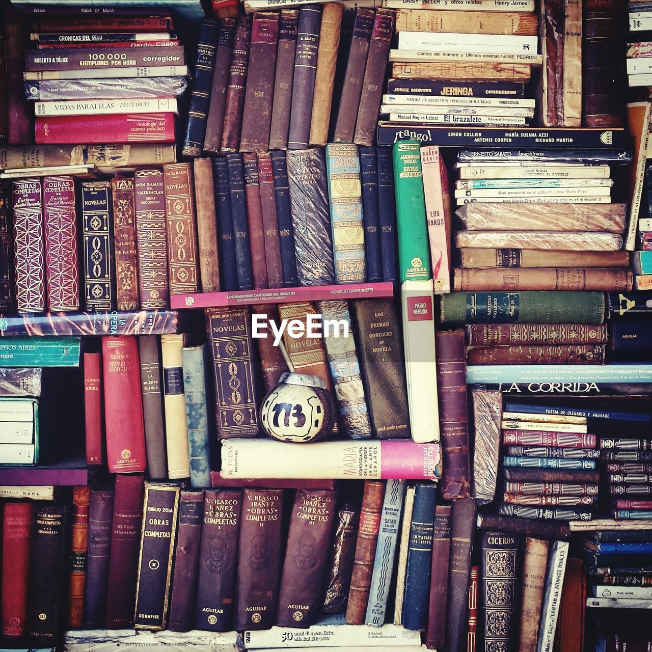 Old books stacked on shelf