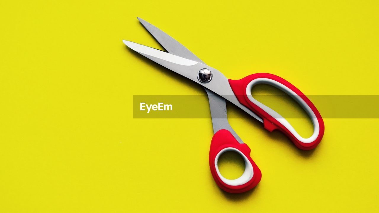 scissors, studio shot, still life, indoors, work tool, no people, colored background, equipment, cut out, yellow, metal, copy space, close-up, yellow background, steel, tool, red, hand tool, shape, sharp