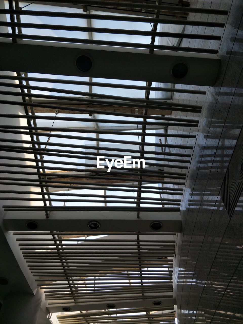indoors, ceiling, low angle view, no people, architecture, day