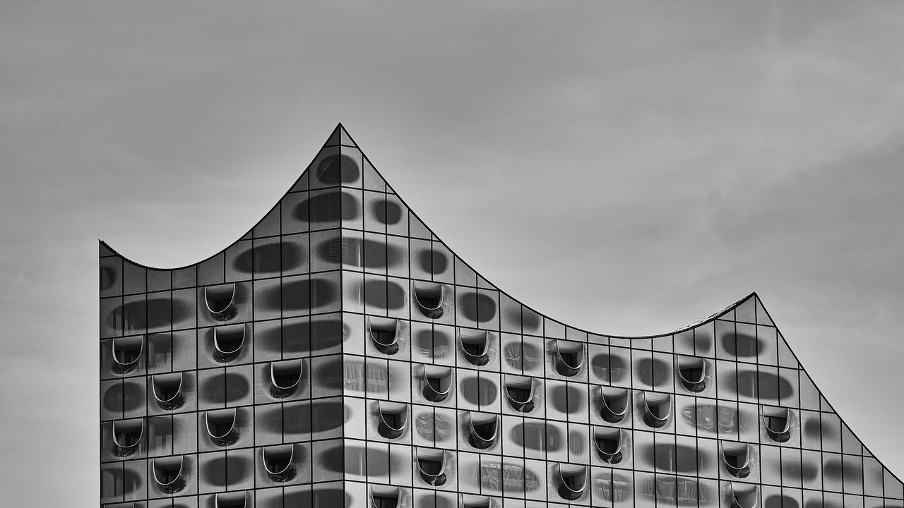 sky, built structure, architecture, building exterior, nature, no people, day, low angle view, cloud - sky, outdoors, building, city, modern, metal, office, travel destinations, high section, connection, pattern
