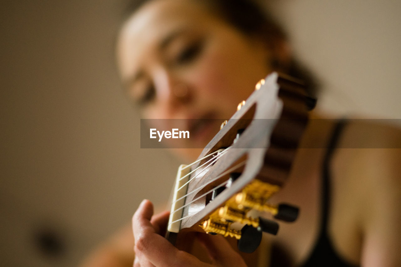 Close-Up Woman Playing Guitar