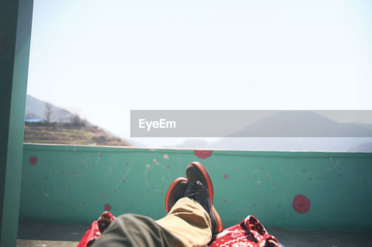 low section, personal perspective, human leg, human foot, one person, human body part, point of view, shoe, adults only, adult, people, one man only, horizon over land, only men, day, relaxation, lifestyles, adventure, scenics, vacations, sky, men, clear sky, outdoors, mountain, nature, young adult, close-up