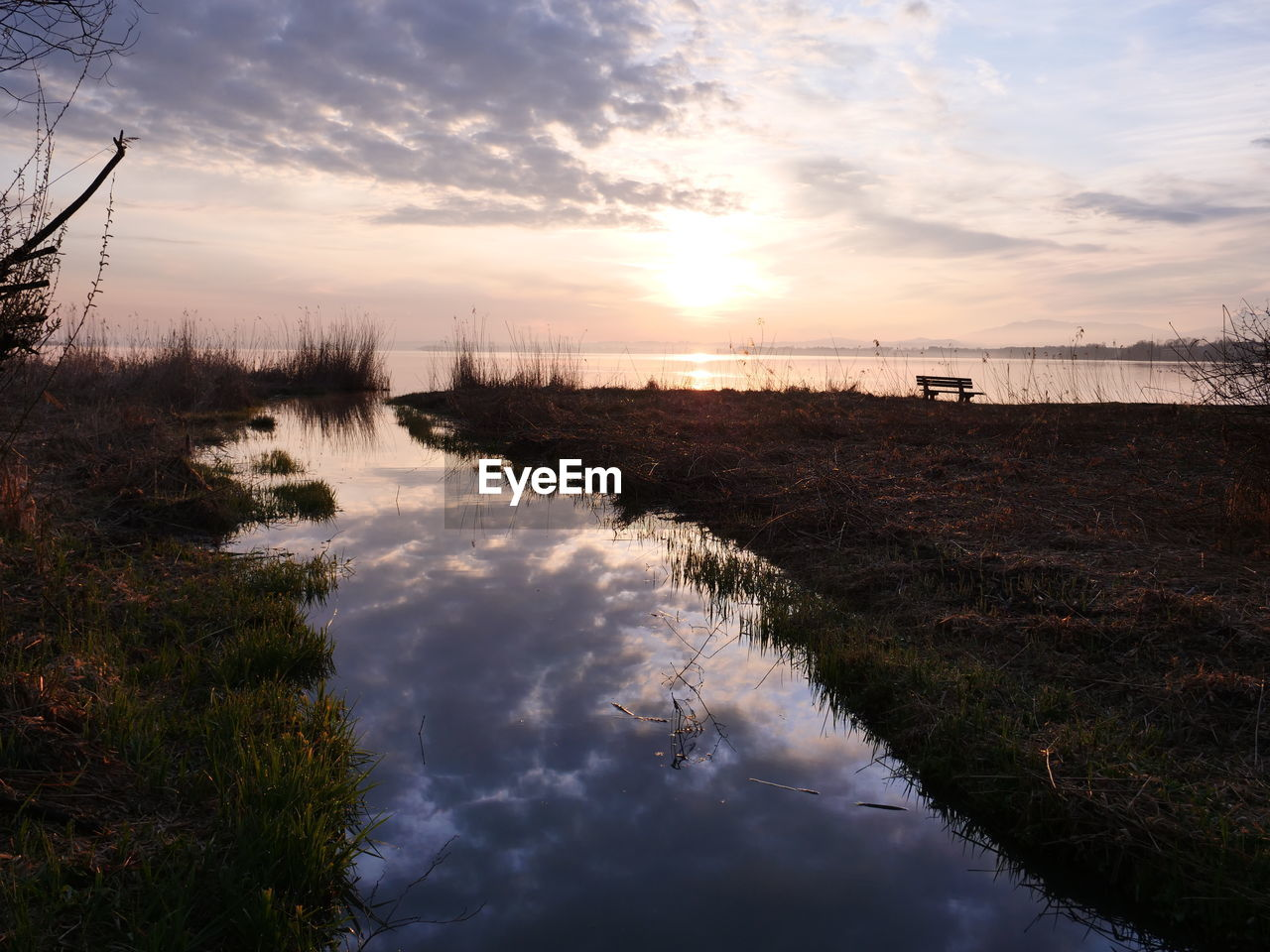 sky, water, cloud - sky, sunset, scenics - nature, nature, tranquility, tranquil scene, plant, no people, beauty in nature, reflection, grass, non-urban scene, land, lake, outdoors