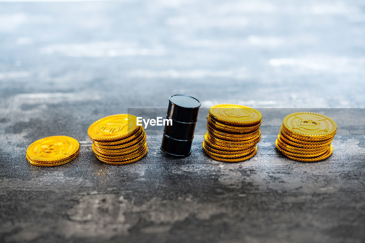 still life, no people, close-up, table, food and drink, finance, yellow, indoors, coin, group of objects, wood - material, stack, food, large group of objects, focus on foreground, selective focus, arrangement, side by side, variation, freshness, economy