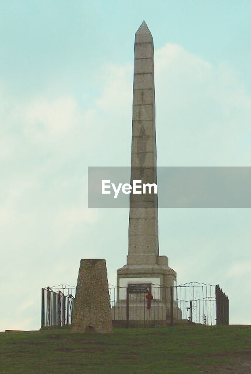 tall - high, built structure, architecture, sky, history, low angle view, monument, day, travel destinations, memorial, outdoors, no people, skyscraper, city, grass, ancient civilization