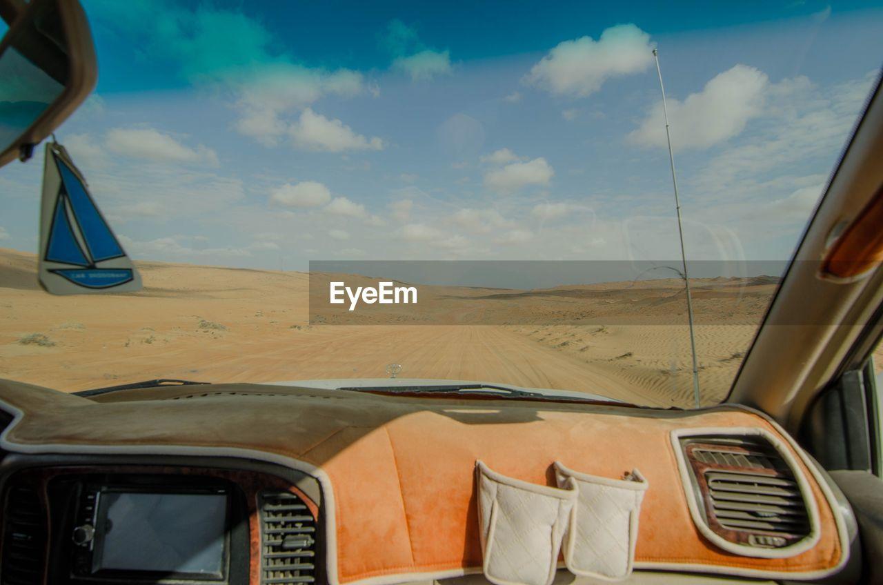 PANORAMIC SHOT OF CAR ON DESERT