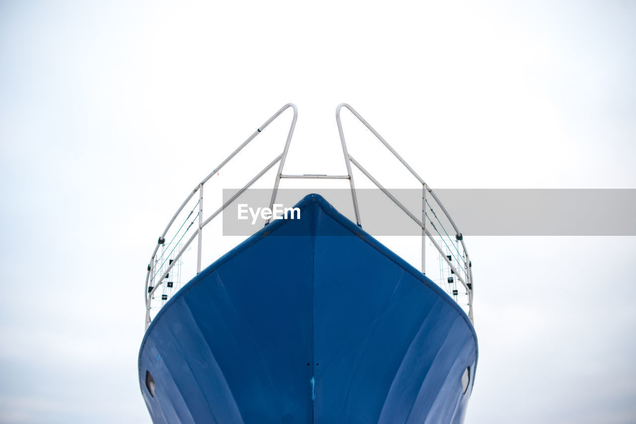 Low angle view of ship's bow against clear sky
