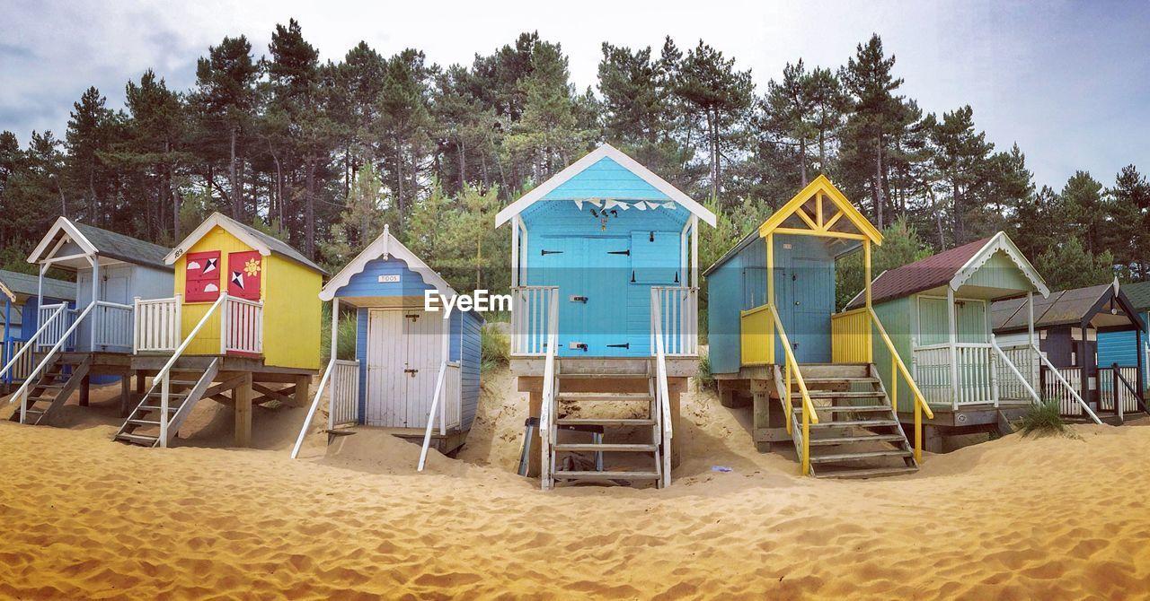 Beach Huts Against Trees