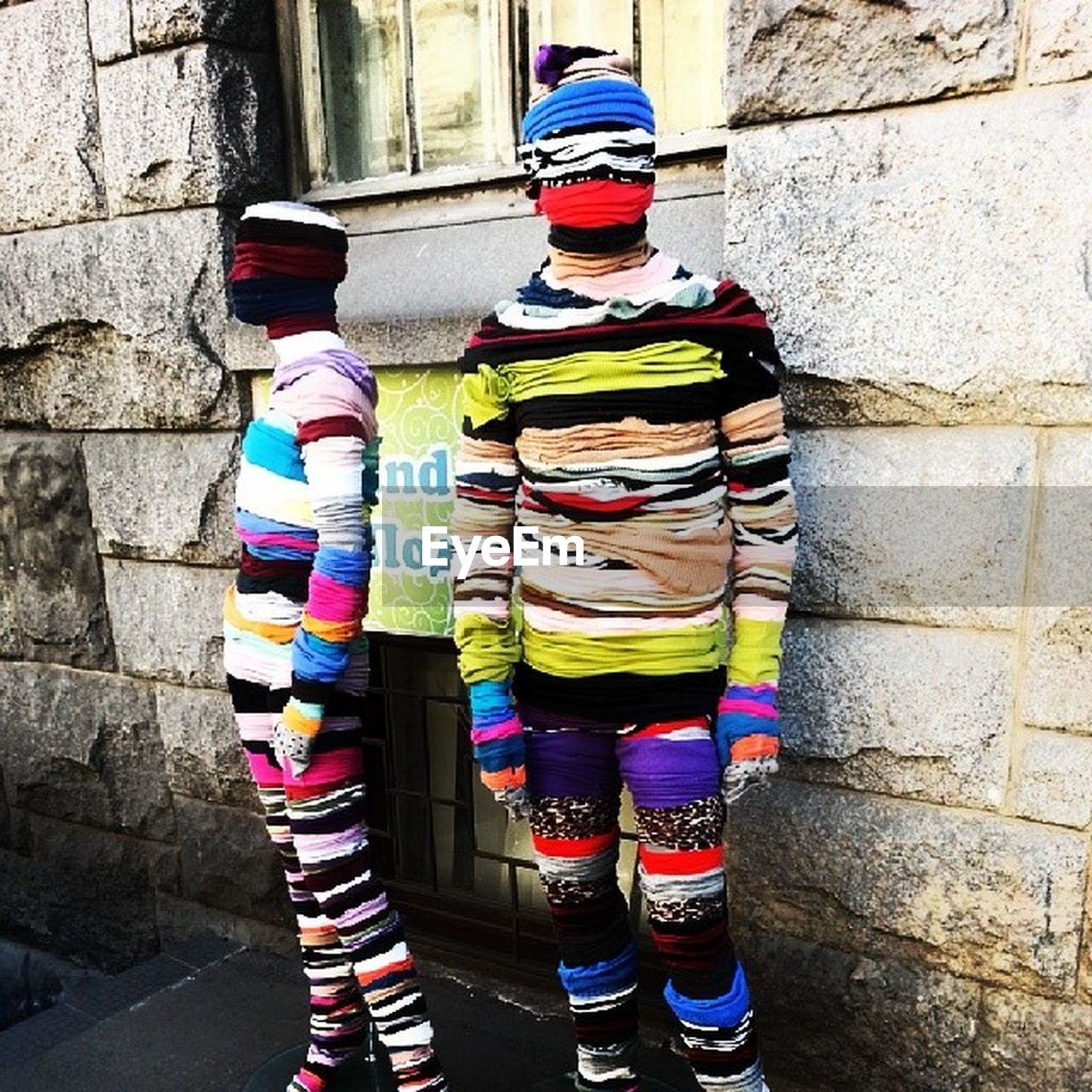 multi colored, building exterior, architecture, built structure, wool, one person, day, real people, outdoors, clown, adult, people