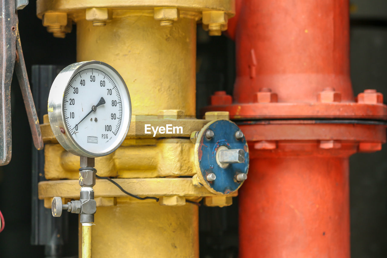 gauge, metal, industry, no people, machinery, close-up, pressure gauge, pipe - tube, focus on foreground, factory, instrument of measurement, equipment, number, red, meter - instrument of measurement, connection, fuel and power generation, machine part, physical pressure, technology, machine valve