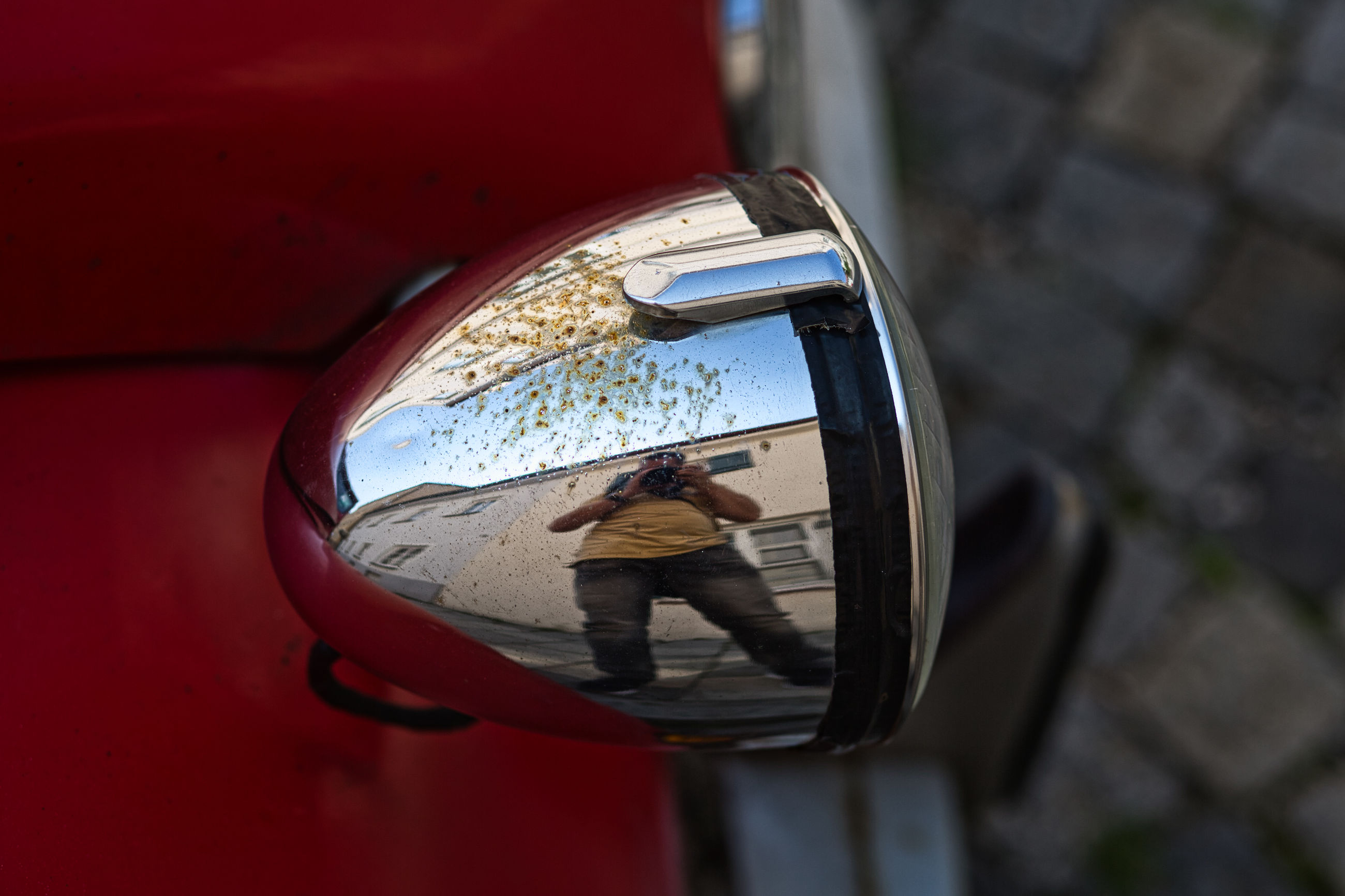 HIGH ANGLE VIEW OF PERSON PHOTOGRAPHING THROUGH CAR
